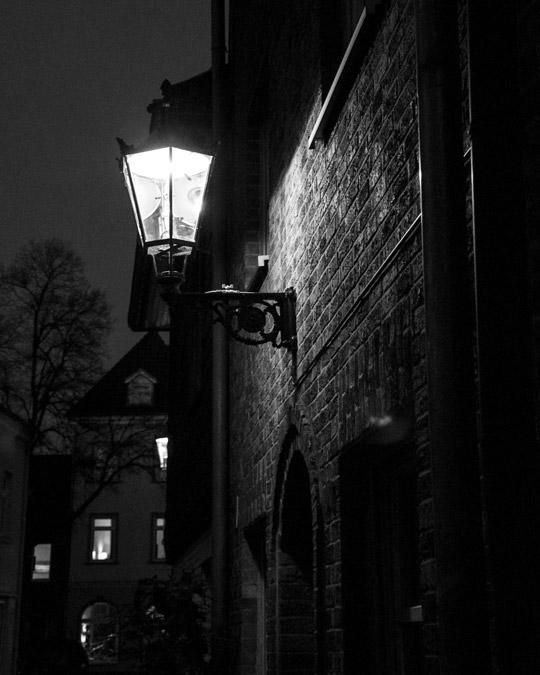 Streetlamp illuminating the brick facade of the historic building in Düsseldorf Kaiserswerth