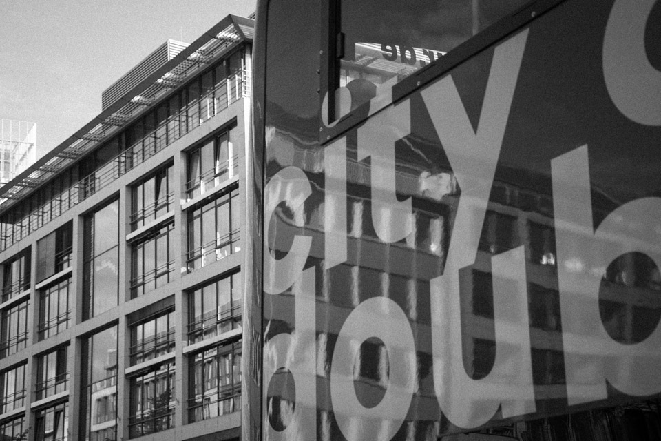 Building and window reflections on the tourist city tour bus dusseldorf