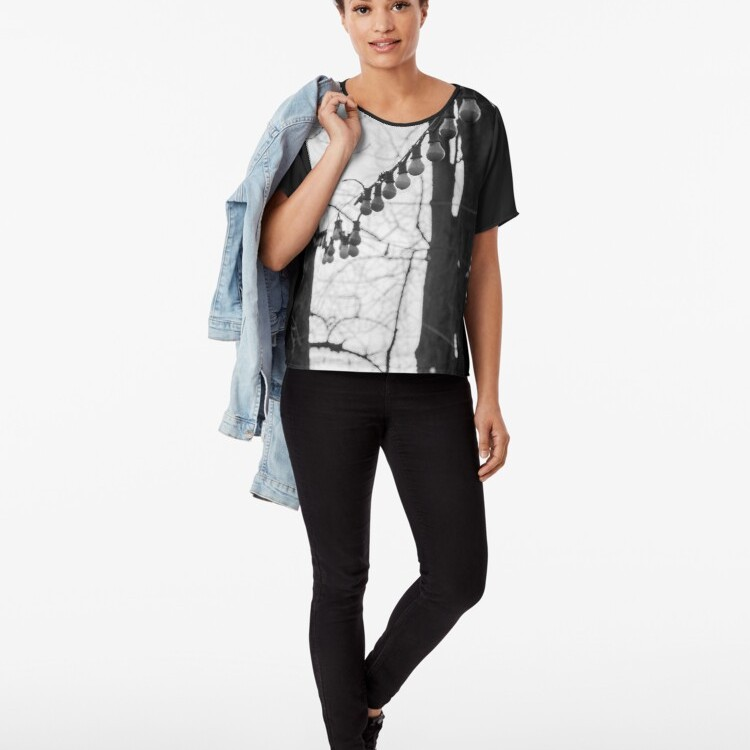 Sheer and slightly silky with an edge-to-edge printed front panel, great for layering